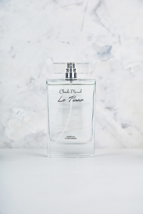 """""""Le Piano"""" is an invigorating aroma created by the ocean and sun. Effortlessly combining a woody base with marine middle notes, Claude Marsal features a light, aromatic scent that embraces the earth and the sea, creating an allure that is impossible to resist. """"Le Piano"""" belongs to the Citrus and Fresh Fragrance Family.  TOP NOTES The perfume opens with Lime, Orange, Lemon, Mandarin Orange, Bergamot, beautiful Jasmine, and Neroli. HEART NOTES It continues to the foundation of delicate Freesia, Cyclamen, Jasmine, Hyacinth, Violet, Rose, Mignonette, Calone, Rosemary, Peach, Nutmeg, Coriander and Sea Notes. BASE NOTES The last touch of the perfume is White Musk, Amber, Oakmoss, Cedar, and Patchouli."""