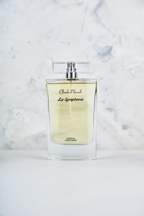 """""""La Symphonie"""" for men, it is a new fragrance for men, which represents fresh and sporty creation. Embracing virility, Claude Marsal mysteriously combines notes of spice and smoke punctuated by a citrus freshness. With top notes of sage, cardamom, and red thyme harmonizing with the middle notes of whiskey, Claude Marsal creates a scent both modern and manly.  """"La Symphonie"""" belongs to the Aromatic and Leather Fragrance Family.  TOP NOTES The perfume opens with Whisky, Pomelo, and Grapefruit. HEART NOTES It continues to the foundation of Cardamom, Sage, Red Thyme, Whisky, and Lavender. BASE NOTES The last touch of the perfume is Benzoin, Tonka Beans, Woody notes, and Leather."""