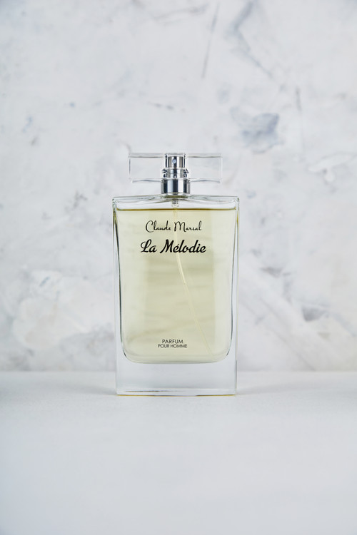 """""""La Melodie"""" for men is an oriental-woody, leather scent, exciting, vibrant and luxurious. The composition combines layers of explosive whiskey accords. """"La Melodie"""" is an unpredictable clash between the rich base notes of oak moss and guaiac wood and the fresh top notes of grapefruit and an ozone accord. A magnificent combination of woody and aquatic scents, Claude Marsal, epitomizes masculinity and vigor. """"La Melodie"""" belongs to the Aromatic and Spicy Fragrance Family.  TOP NOTES The perfume opens with Mandarin, Grapefruit and Sea Notes. HEART NOTES It continues to the foundation of luxurious Jasmine and Bay Leaf. BASE NOTES The last touch of the perfume is Oakmoss, Guaiac Wood, Ambergris, Patchouli and explosive Whiskey."""