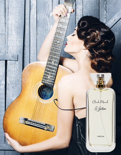 """La Guitare"" is a perfume for powerful and confident women with inner courage, she who was born to rule the world; majesty and brilliance are the true definitions of this perfume.  THE NOTES TOP NOTES The perfume opens with Patchouli, Egyptian Green Apple, Italian Bergamot, precious Violet, Lemon and Pink Pepper. HEART NOTES It continues to the foundation of pure and precious Turkish Rose, Sandalwood, Styrax, and Musk. BASE NOTES The last touch of the perfume is delicious Peach, Black Currant, Ylang-Ylang, Lilac and Amber unfolding the entire soul of the perfume."