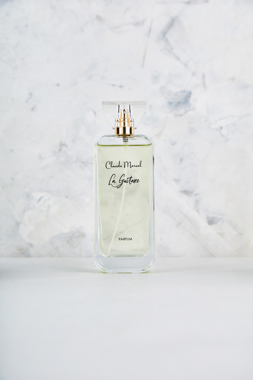 """""""La Guitare"""" is a perfume for powerful and confident women with inner courage, she who was born to rule the world; majesty and brilliance are the true definitions of this perfume.  THE NOTES TOP NOTES The perfume opens with Patchouli, Egyptian Green Apple, Italian Bergamot, precious Violet, Lemon and Pink Pepper. HEART NOTES It continues to the foundation of pure and precious Turkish Rose, Sandalwood, Styrax, and Musk. BASE NOTES The last touch of the perfume is delicious Peach, Black Currant, Ylang-Ylang, Lilac and Amber unfolding the entire soul of the perfume."""