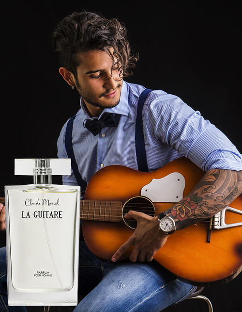 """La Guitare"" for men is the embodiment of a strong masculine fragrance, both powerful and sophisticated with provocative passion and the right amount of royalty.   THE DESIGN ""La Guitare"" belongs to the fruity and sweet fragrance family. Its overture is floral notes, followed by patchouli and floral notes. Woody notes are the grand finale that unfolds the entire body of the perfume.   THE NOTES TOP NOTES The perfume opens with Pineapple, Green Apple, Black Currant and Bergamot.  HEART NOTES It continues to the foundation of delicate Red Rose, Moroccan Jasmine, Patchouli, Pink Berries, and Birch. BASE NOTES The last touch of the perfume is Musk, Oak Moss, Vanilla, and Ambergris."