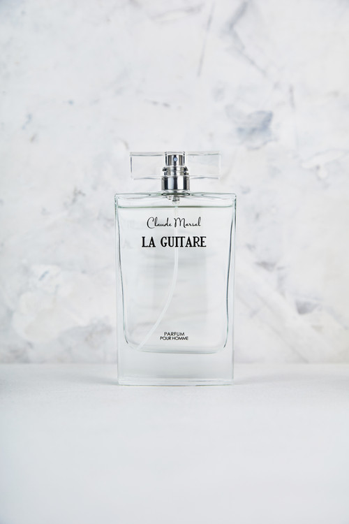 """""""La Guitare"""" for men is the embodiment of a strong masculine fragrance, both powerful and sophisticated with provocative passion and the right amount of royalty.   THE DESIGN """"La Guitare"""" belongs to the fruity and sweet fragrance family. Its overture is floral notes, followed by patchouli and floral notes. Woody notes are the grand finale that unfolds the entire body of the perfume.   THE NOTES TOP NOTES The perfume opens with Pineapple, Green Apple, Black Currant and Bergamot.  HEART NOTES It continues to the foundation of delicate Red Rose, Moroccan Jasmine, Patchouli, Pink Berries, and Birch. BASE NOTES The last touch of the perfume is Musk, Oak Moss, Vanilla, and Ambergris."""