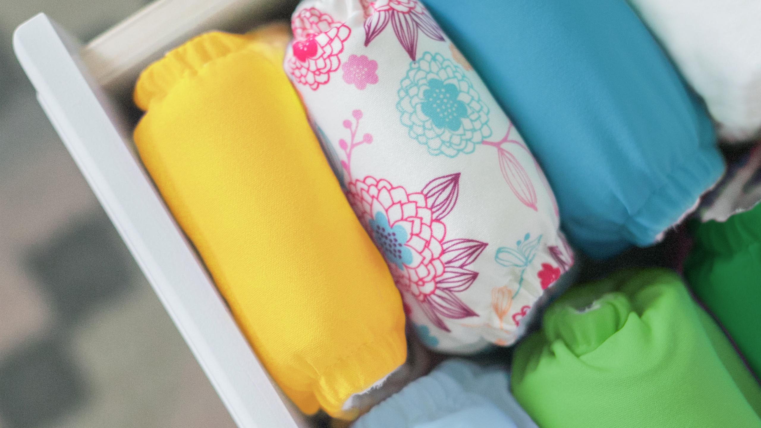 drawer full of Charlie Banana Reusable Cloth Diapers