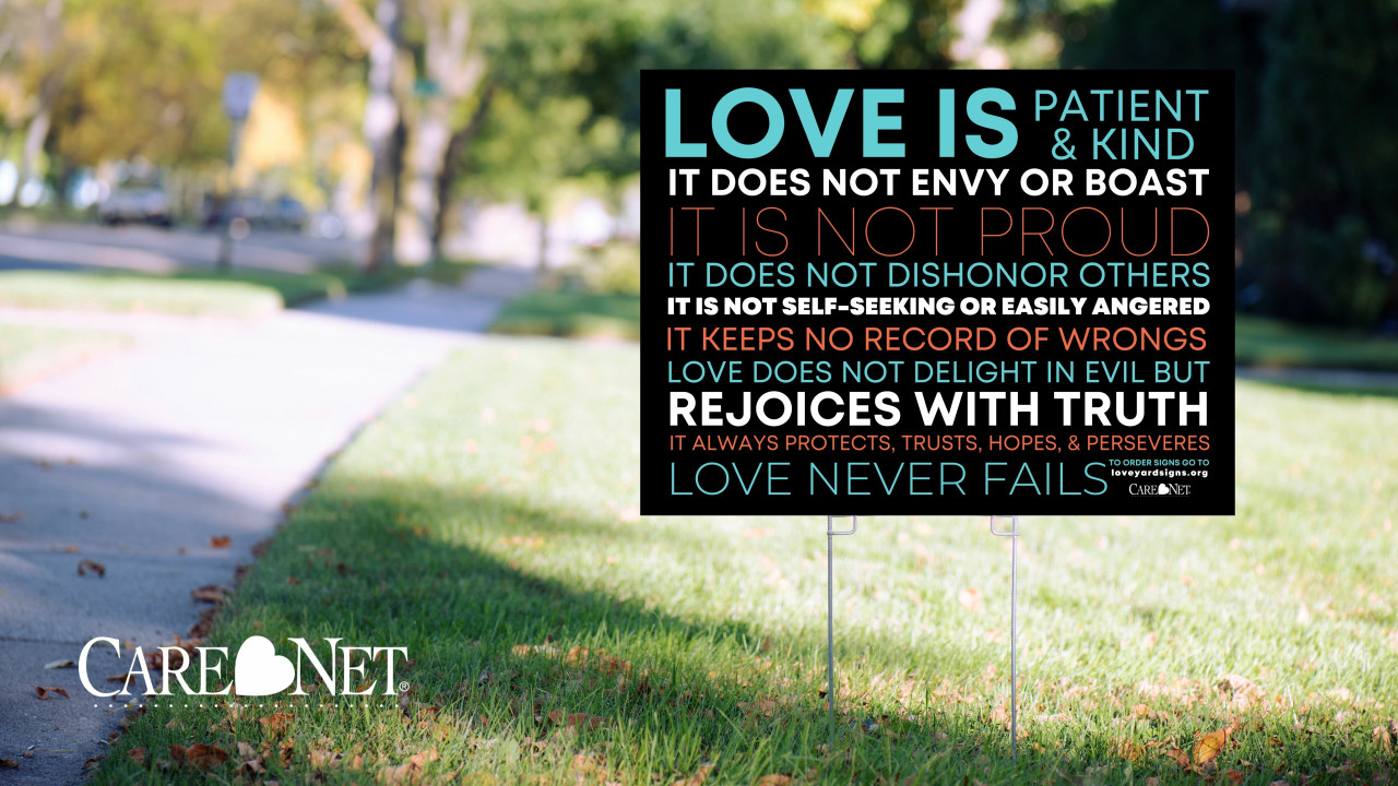 """""""Love is..."""" Yard Sign - Pack of 10"""