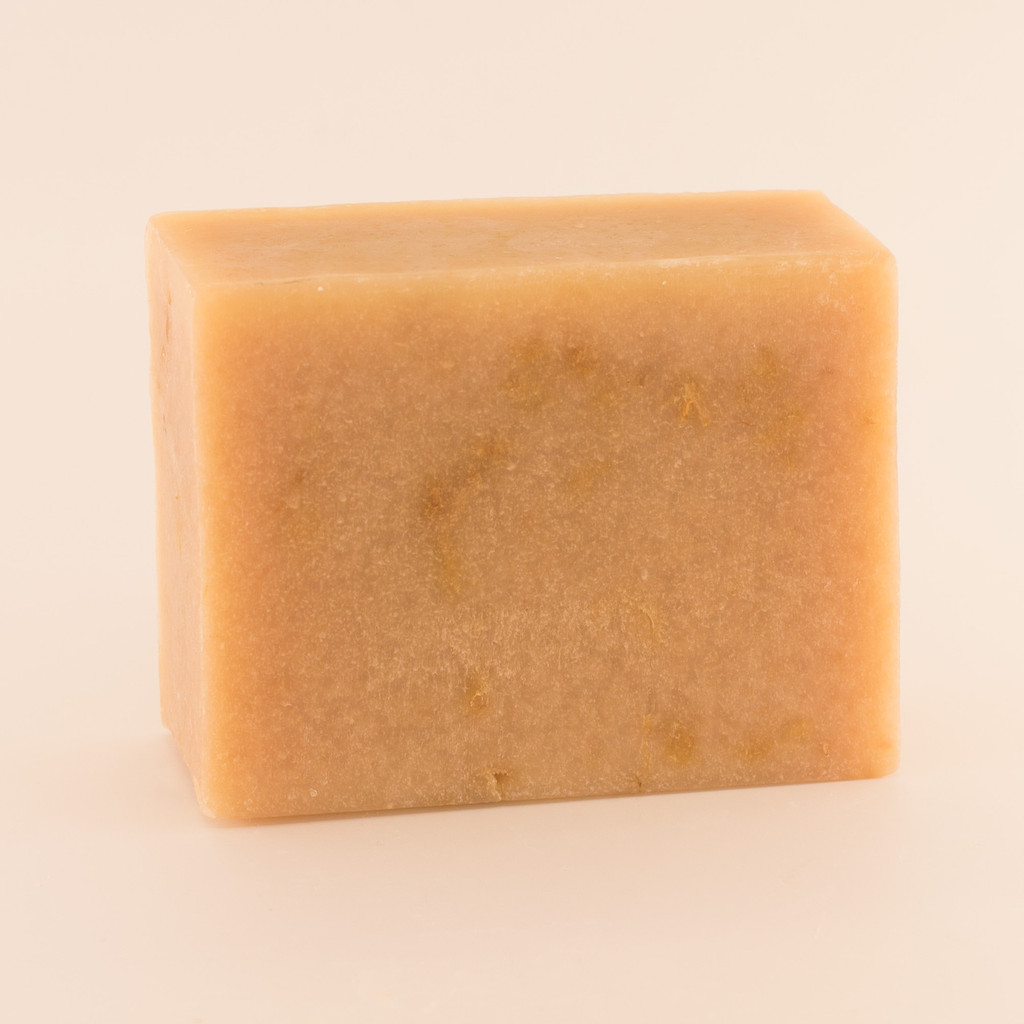 Unwrapped bar of Calendula goat milk soap.
