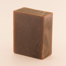 Unwrapped bar of discounted Pine Tar goat milk soap.