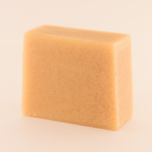 Unwrapped bar of discounted Sweet Orange Basil goat milk soap.
