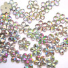 10 mm flat back acrylic sew-on rhinestone in flower shape with clear iridescent color.