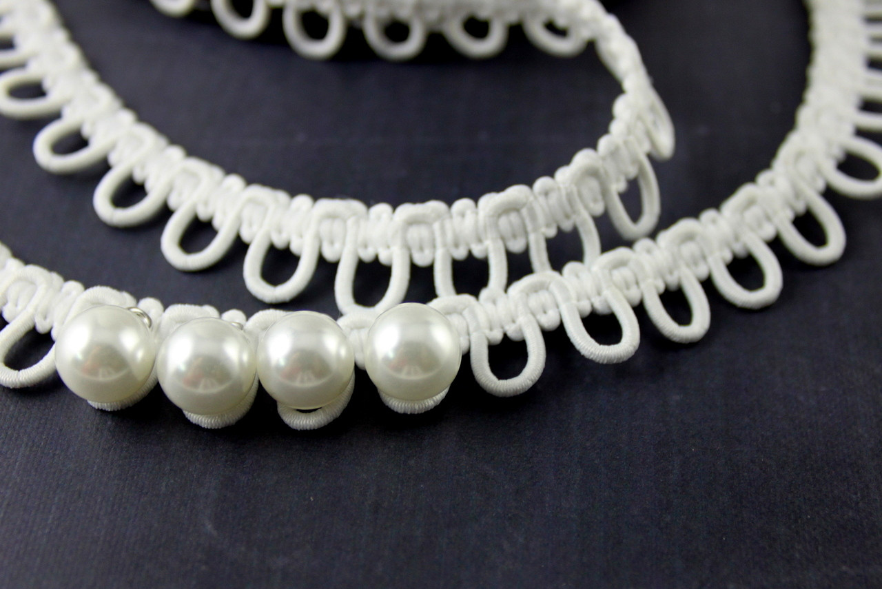 Bridal loops for wedding dress buttons.