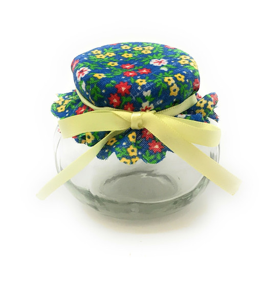 4 oz round Glass Jar with Blue with Flowers jar cover and yellow ribbon