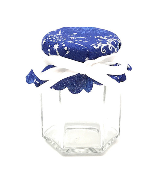 3.75 Hexagon Glass jar with White Snowflakes on Blue Jar Cover and white ribbon