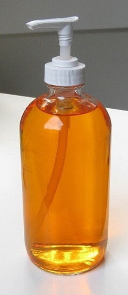 16 oz Clear Glass Boston Round Bottle with Silver Aluminum Cap