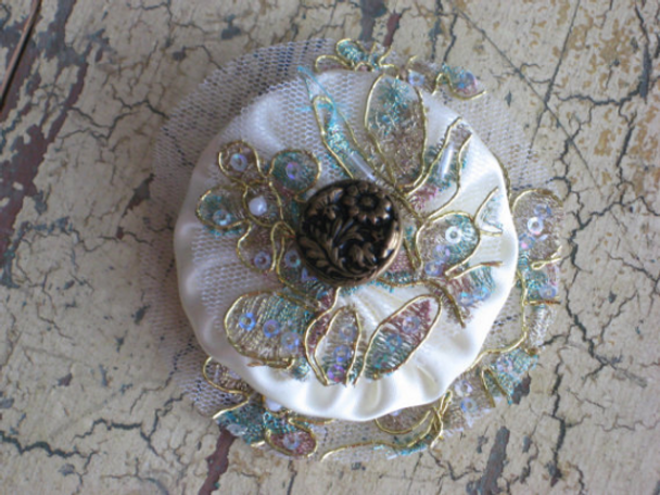 Fabric yoyo appliques made from satin.