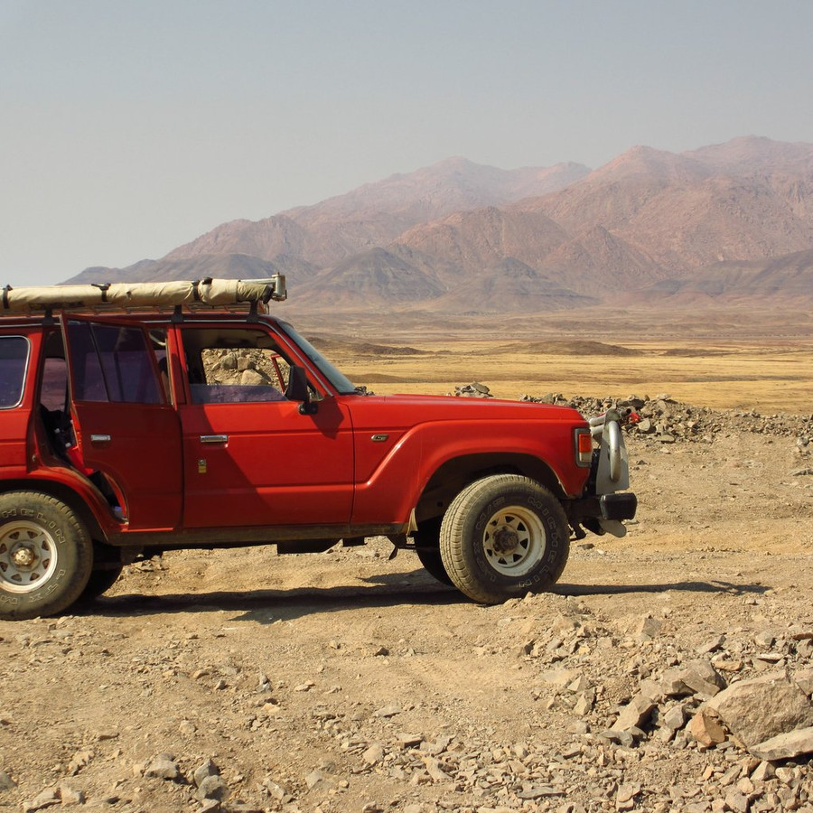 The Land Rover we rented, with the wilderness of Brandberg (Namibia) mining country in the background.