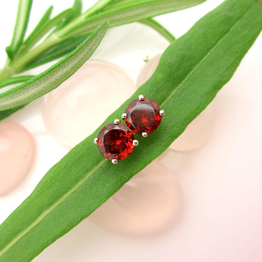 Red garnet stud earrings in 14k white gold