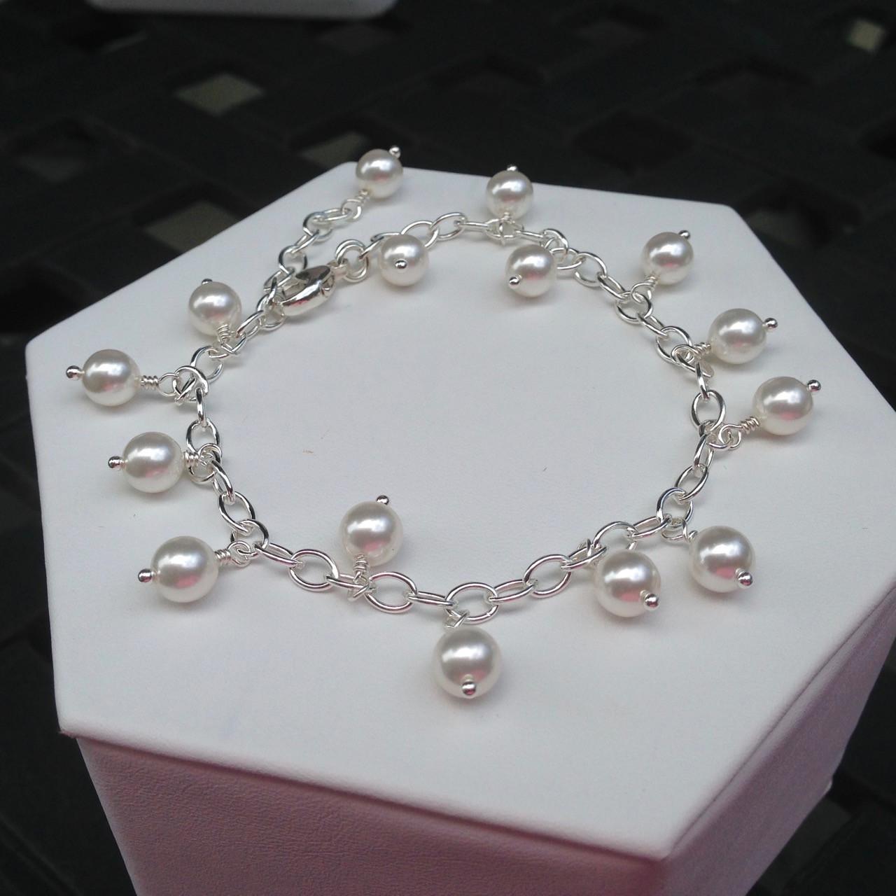 8218881fc0d80 Dangling Swarovski pearl bracelet