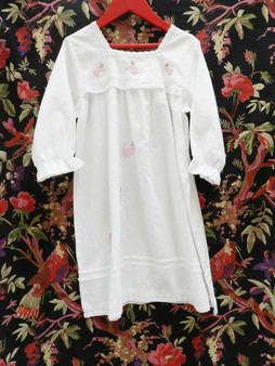 Pretty design with long sleeves, lace trims, elasticated cuffs and embroidered fairies.