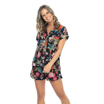 Short pajama set for women in arabella floral black print cotton fabric. The pajama top fastens with fabric covered buttons, and the bottom have 2 internal side pockets and drawstring waist for comfort.