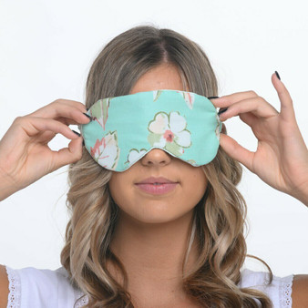 Printed cotton eye mask with satin back and elasticated headband. Comes in a matching fabric bag with a drawstring tie