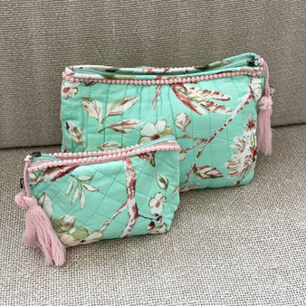 Blossom mint quilted, lined wash bag with pom pom trim and a tassel zip pull.