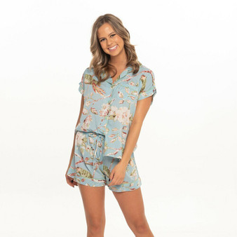 Short pajama set for women with blossom print in mint cotton fabric. The pajama top fastens with fabric covered buttons, and the bottom have 2 internal side pockets and drawstring waist for comfort.