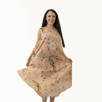 Summer bias cut loose fitting dress in 100% cotton peach fabric with blossom and floral prints