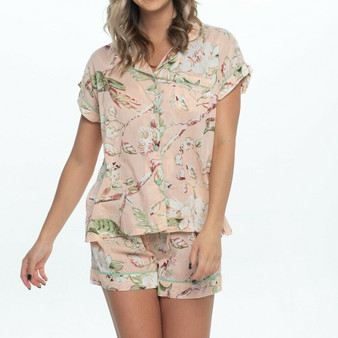 Short pajama set for women in blossom peach cotton fabric. The pajama top fastens with fabric covered buttons, and the bottom have 2 internal side pockets and drawstring waist for comfort.
