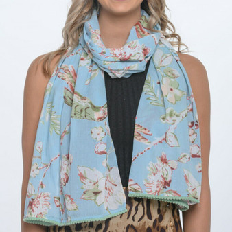 100% cotton sky blue blossom print scarf/sarong with pom-pom trimmed ends and are luxuriously long – 180 x 50cm, long enough to drape and tie in lots of different stylish ways.