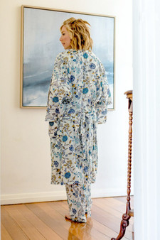 3/4 sleeve printed blue floral accentuated with mustard yellow in a white base fabric. The dressing gown/kimono fastens with a long tie belt.