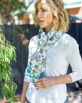 100% cotton blue & white floral scarf with pom-pom trimmed ends and are luxuriously long – 180 x 50cm, long enough to drape and tie in lots of different stylish ways.