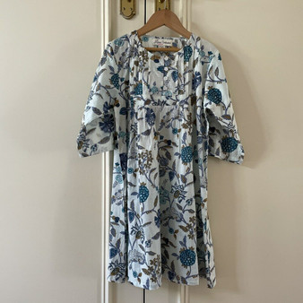 Pretty nightdress printed with blue and white floral- this print has a fresh white background and is printed with stylised carnations and chrysanthemums in sheds of blue with mustard highlights.