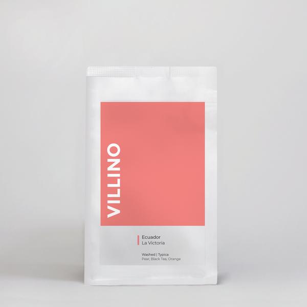 A bag of Single Origin Coffee on a white background. The coral coloured label on the bag says Villino, and reads 'Ecuador La Victoria'