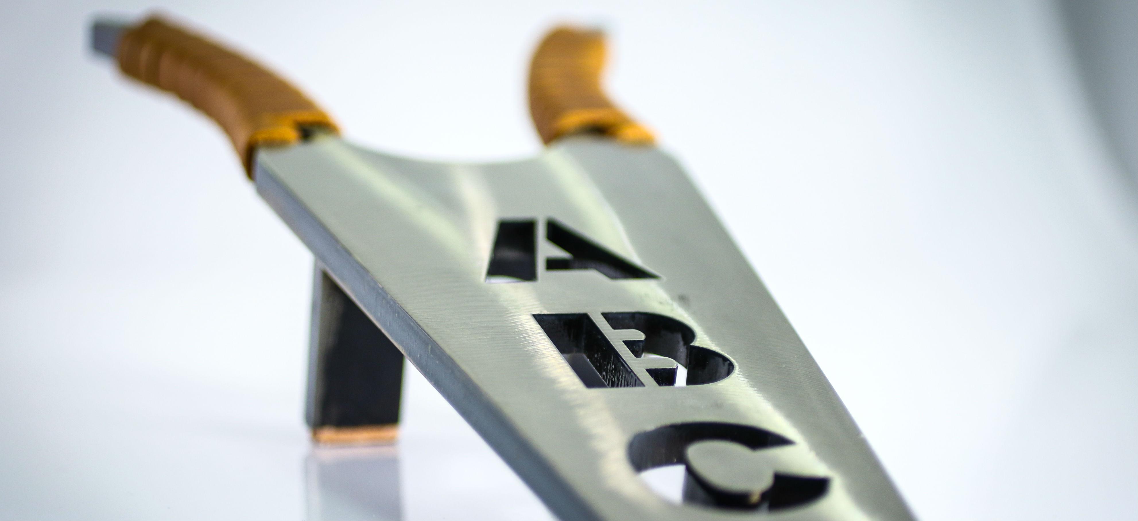 closeup of a custom made, high polished, metal boot jack