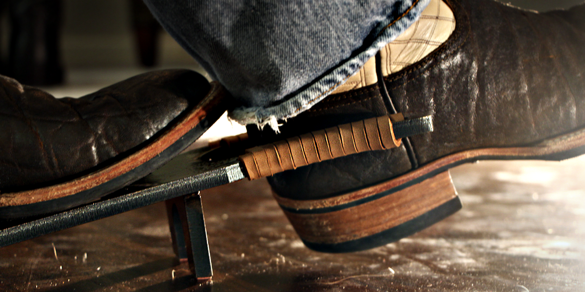 a boot jack pulling off a cowboy boot