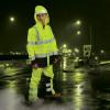 Alpha Workwear Class E Hi Vis Glow in Dark Illuminated Rain Pants A266 In Use