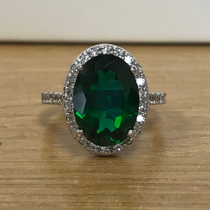 Brenina 5.5 Carat Oval Simulated Emerald CZ Halo Ring