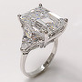 Emerald Starburst Cut Three Stone Cubic Zirconia Trillion Ring