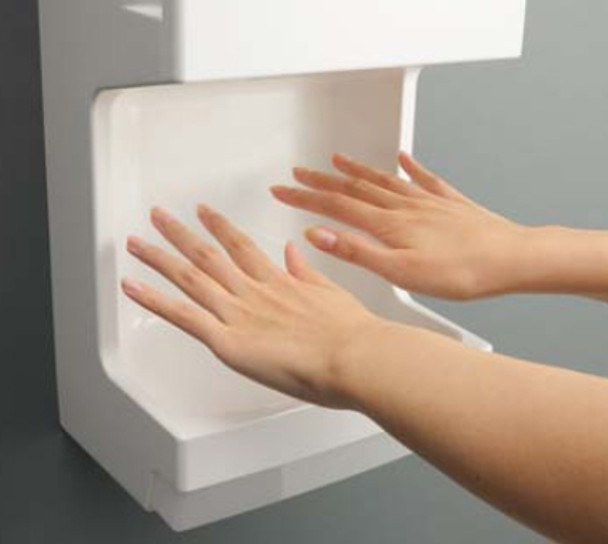White Mitsubishi Jet Towel JT-MC106G-W-NA Mini Hand Dryer in use