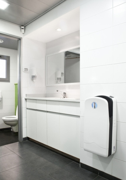 White Veltia V7 hand dryer mounted to the wall