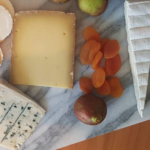 Cheese platter blue hard brie soft cheese crackers quince paste fruits
