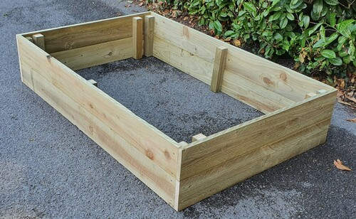 Raised wooden planters, available in different sizes and widths. We can also custom  make any size