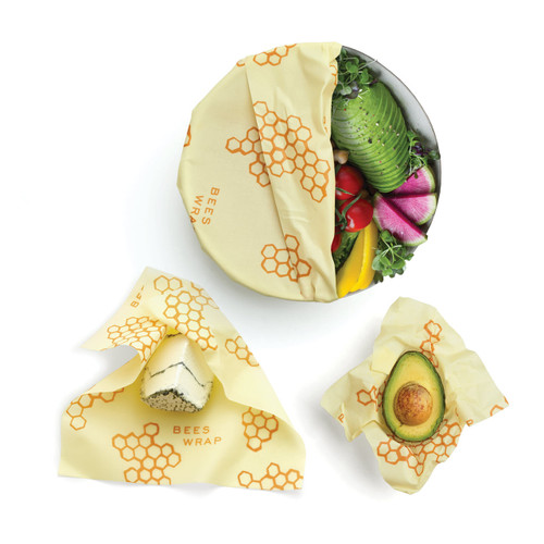 Bees Wrap Honeycomb Print Assorted 3 pack covering a bowl, cheese and an avocado.
