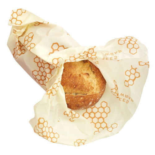 Bee's Wrap in Honeycomb Print wrapping bread on a white background