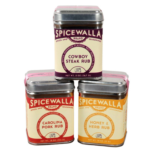 The 3 tins of the Spicewalla Grill and Roast Collection stacked on a white background