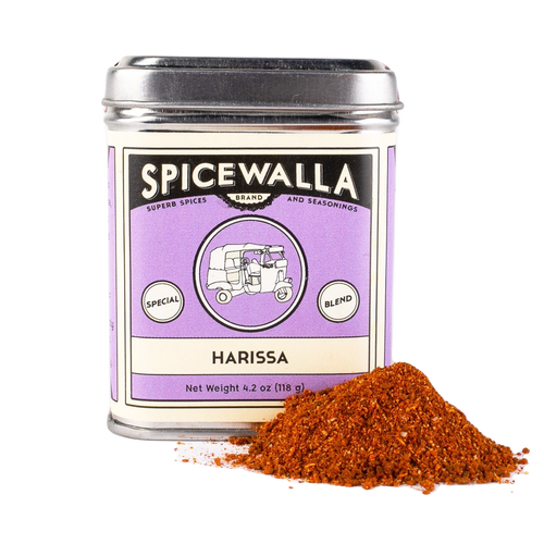 Spicewalla Harissa 4.2 Ounce Tin with some of the harissa spice blend next to it on a white background