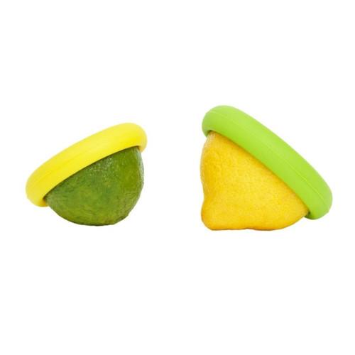 Food Huggers Citrus Savers hugging lime and lemon halves on a white background