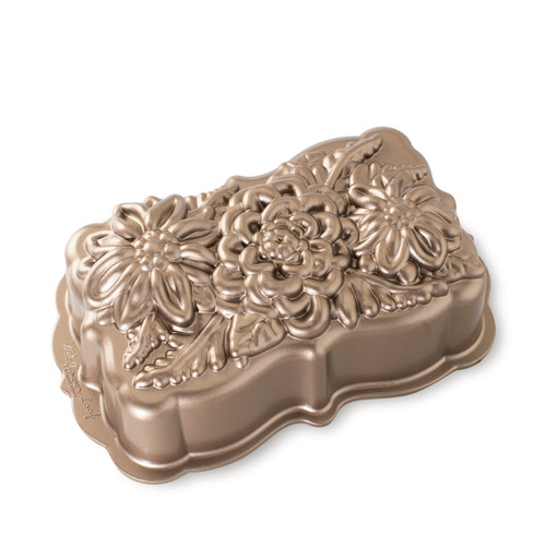 Nordic Ware Wildflower Loaf Pan Toffee on a white background with design side up