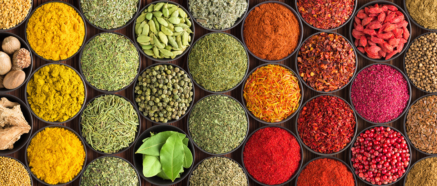 Colorful spices in round containers