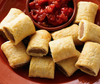 Patties Mini Party Sausage Rolls with sauce on a platter
